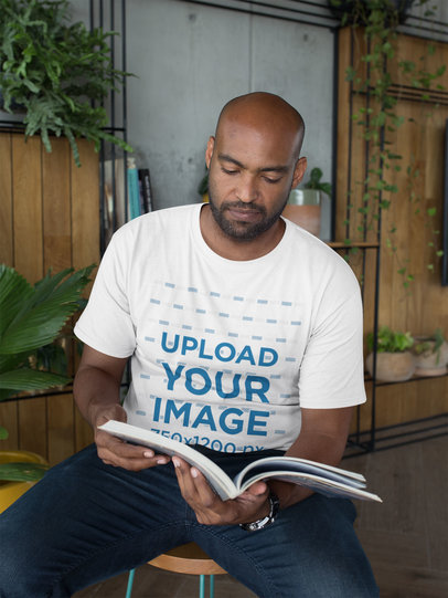 T-Shirt Mockup of a Man Reading a Book 21705