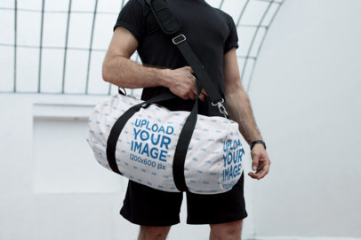 Mockup of a Kit Bag Carried Around a Man's Shoulder 23062
