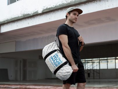 Mockup of a Man Carrying a Duffel Bag Outside a Building Under Construction 23063