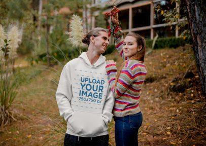 Hoodie Mockup Featuring a Couple Under Christmas Mistletoe 23511