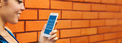 iPhone 6 Mockup Template of a Young Lady Against a Brick Wall a4249