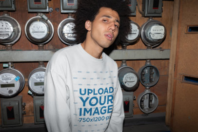 Crewneck Sweater Mockup Featuring a Man Standing Against Electricity Meters 22302