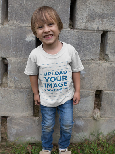 T-Shirt Mockup Featuring a Smiling Little Boy 17944