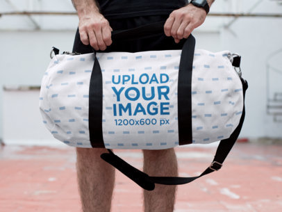 Mockup of a Man Holding a Duffle Bag 23064
