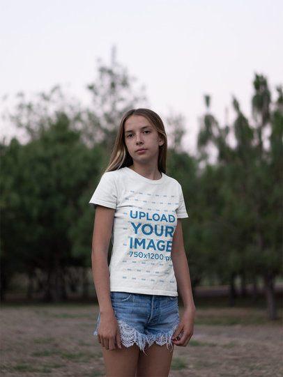 T-Shirt Mockup Featuring a Teen Girl in a Grassland 20734