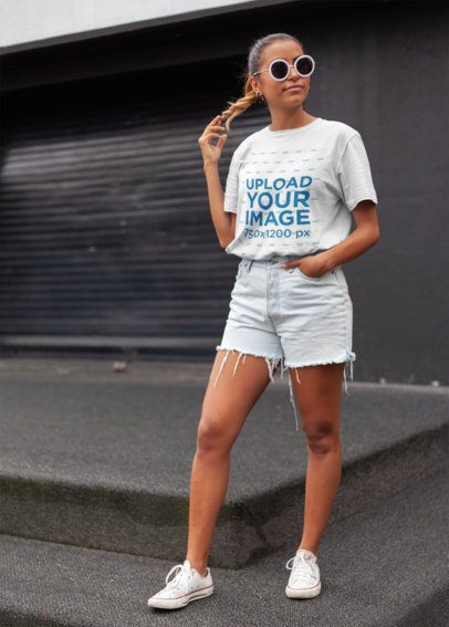 Unisex T-Shirt Mockup of a Stylish Woman in the Street 22790