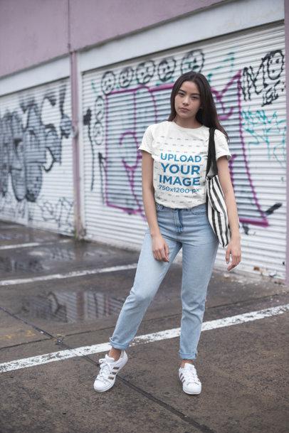 Unisex T-Shirt Mockup Featuring a Girl at an Urban Scenario 23003