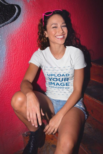 Mockup of a Happy Girl Wearing a Round Neck Tee Sitting on a Stairway 22289