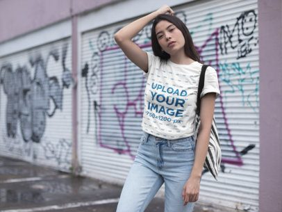 Mockup of a Serious Girl Wearing a Tshirt Standing Against Urban Art 23004