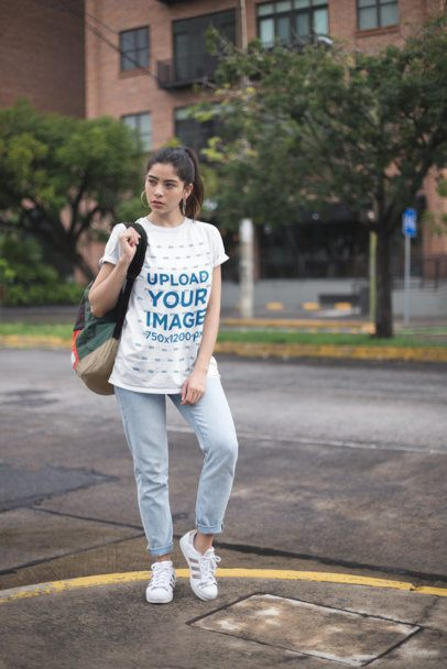Mockup of a Casual Young Woman Wearing a Unisex Tee in the City 23013