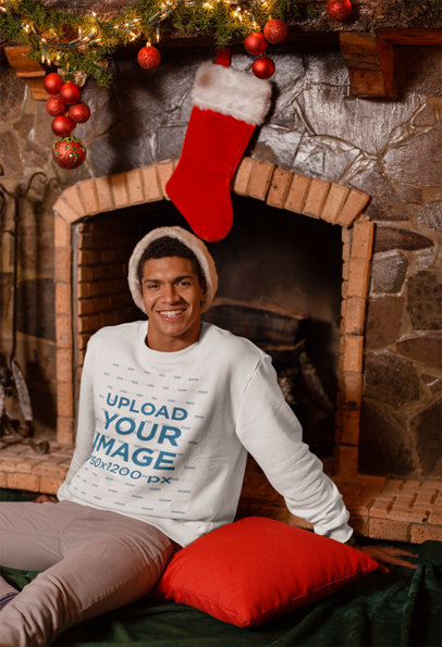 Sweatshirt Mockup Featuring a Man Sitting Under a Christmas Stocking 23523