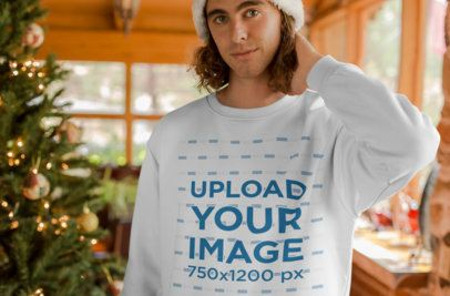 Sweater Mockup of a Blonde Man by a Christmas Tree 23514