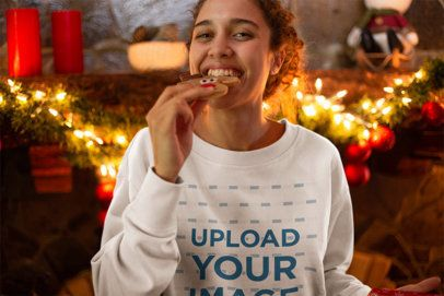 Sweatshirt Mockup Featuring a Young Woman Eating a Christmas Cookie 23525
