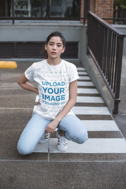Unisex Tee Mockup of a Woman Posing in a Parking Lot 23008
