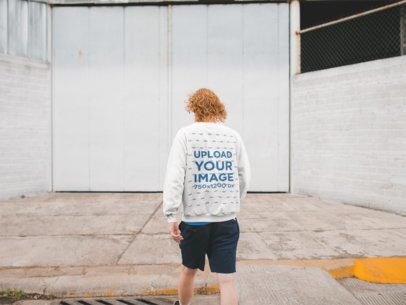 Back View Sweatshirt Mockup of a Red-Haired Man Walking Away From the Camera 21198