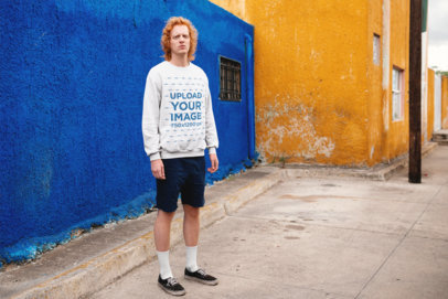 Crewneck Sweater Mockup of a Red-Haired Man in Front of Colorful Walls 21191