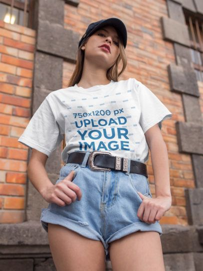 Mockup of a Chic Woman Wearing a Unisex Tee Looking down at the Camera 22952
