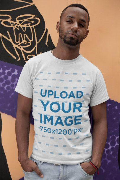 T-Shirt Mockup of a Man Leaning on a Wall with Street Art 22767a