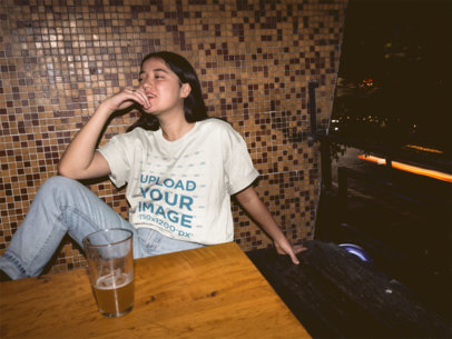 Unisex Tee Mockup Featuring a Cool Girl at a Bar 18857