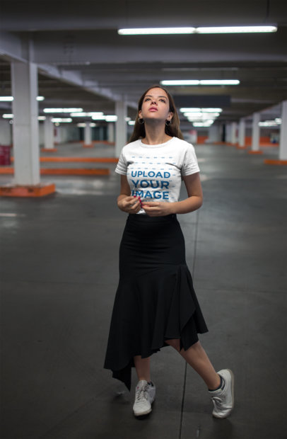 Tshirt Mockup of a Woman Wearing a Black Skirt and Sneakers in a Parking Lot 20693