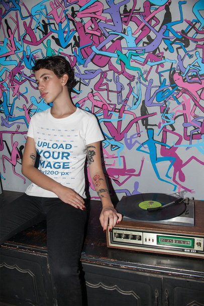 T-Shirt Mockup of an Alternative Woman Listening to a Record Player 22212