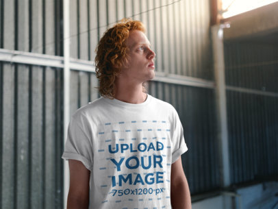 T-Shirt Mockup Featuring a Red-Haired Man Looking up at the Ceiling 21208