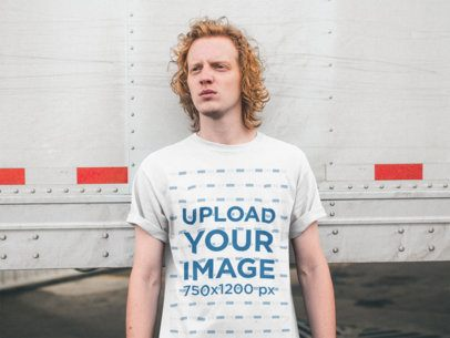 Tee Mockup of a Man with Red Hair Leaning on a Reefer Trailer 21206