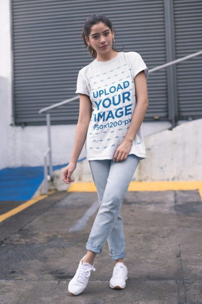 Unisex T-Shirt Mockup of a Girl Outside a Closed Store 23015