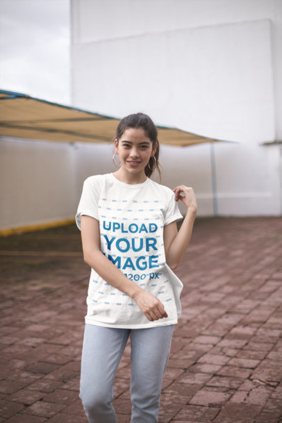T-Shirt Mockup Featuring a Happy Woman Posing at a Patio 23012
