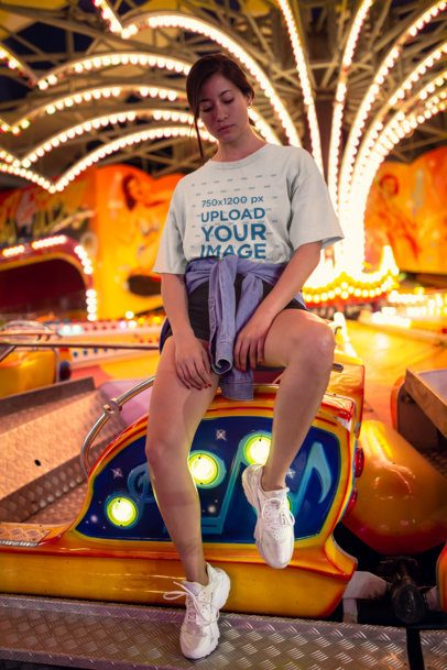 Mockup of a Unisex Tee Featuring a Cool Woman on a Fair Ride 22981