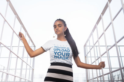 T-Shirt Mockup of a Girl with Braids at an Urban Structure 21811