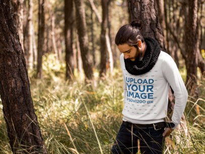 Mockup of a Contemplative Man Wearing a Sweatshirt in the Woods 18033