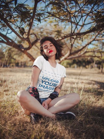 Mockup of an Attractive Woman Wearing a Tee in the Countryside 19738