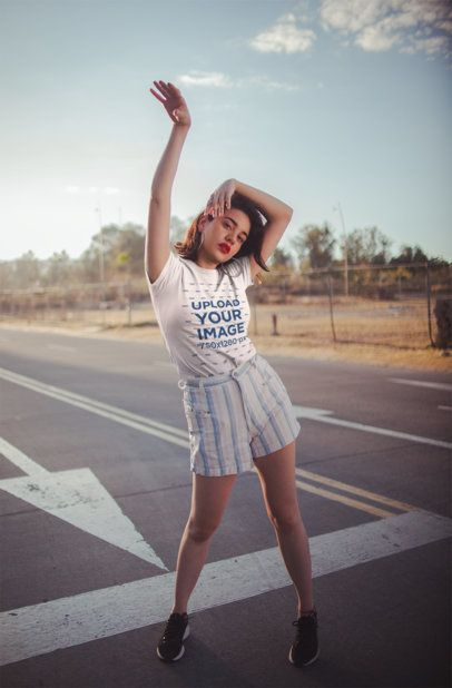 T-Shirt Mockup Featuring an Appealing Woman Posing on a Road 19681