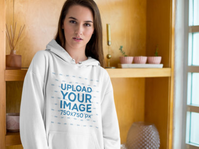 Mockup of a Serious Woman Wearing a Pullover Hoodie in her House 23197