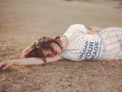 T-Shirt Mockup of a Girl Lying Down on the Grass 19743