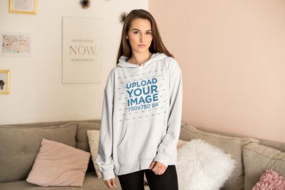 Cute Hoodie Mockup Featuring a Young Woman in Her Living Room 23199