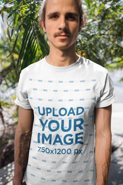 T-Shirt Mockup Featuring a Man with a Hipster Mustache in Front of Plants 20155