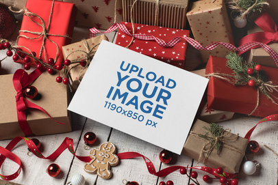 Mockup of a Christmas Card over Gift Boxes and Red Decorations 23835