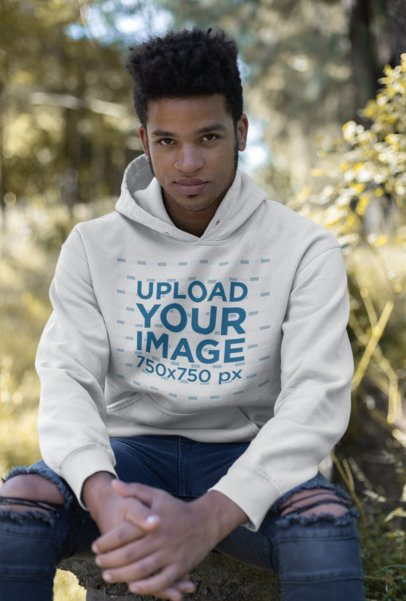 Mockup Featuring a Man With a Sly Smile Wearing a Pullover Hoodie 23194