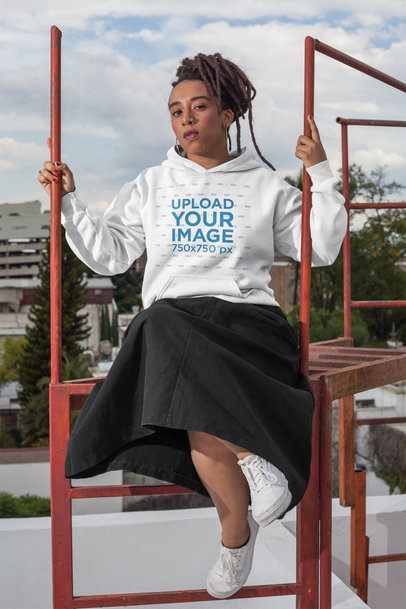 Hoodie Mockup of a Trendy Woman with Locs Wearing a Black Skirt on a Rooftop 23418