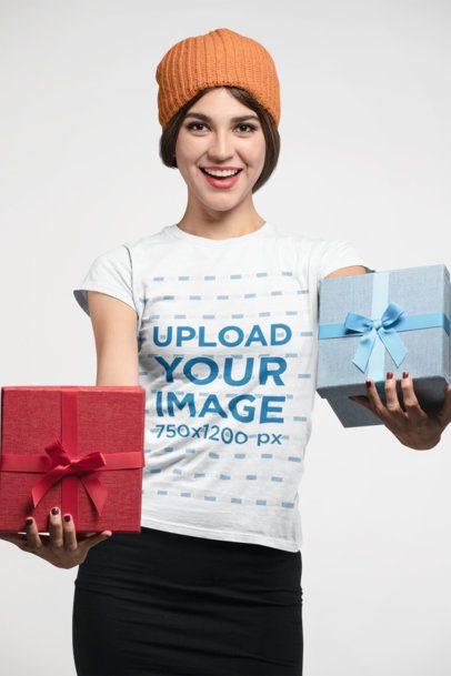 T-Shirt Mockup Featuring a Joyful Woman Holding Christmas Boxes 23885