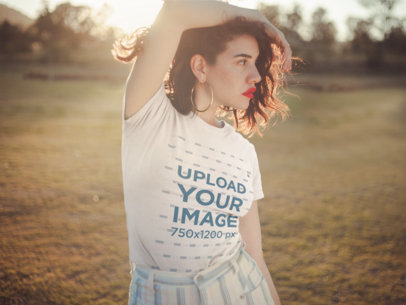 T-Shirt Mockup Featuring a Stylish Woman Posing Outdoors 19683