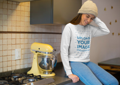 Crewneck Sweatshirt Mockup Featuring a Smiling Young Woman Sitting on Kitchen Counter 23206