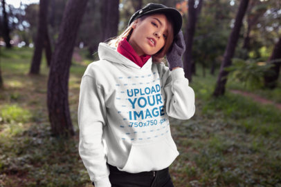 Mockup Featuring a Cool Woman Outdoors Wearing a Warm Hoodie 23271