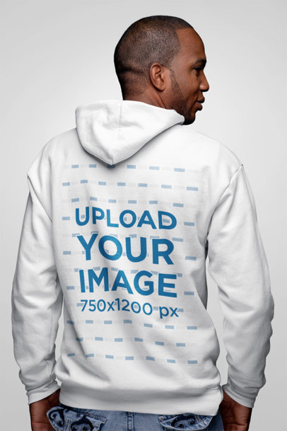 Mockup of a Full Zip Hoodie with a Back view Worn by a Man in Studio 23401