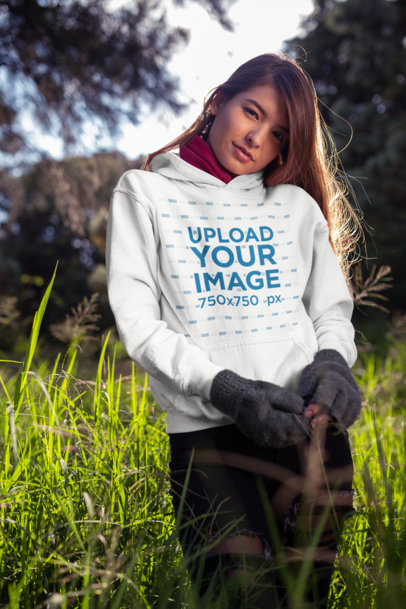 Pullover Hoodie Mockup Featuring a Beautiful Young Woman in the Field 23275