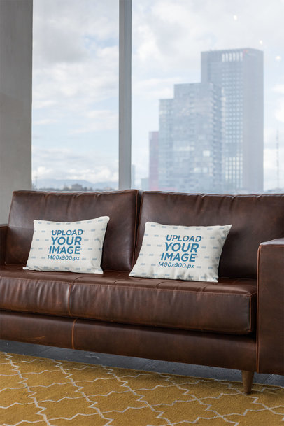 Mockup of Two Pillows on a Leather Sofa 23547