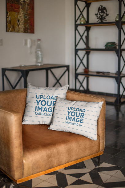 Mockup of Two Throw Pillows on a Leather Couch 23565