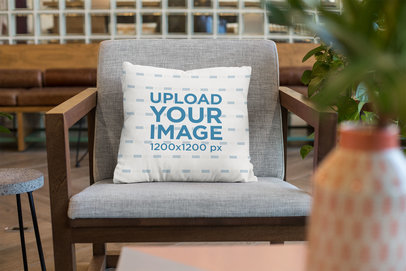 Square Pillow Mockup on an Armchair at a Lounge 23549